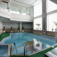 Отель Ramada Beach Аджман бассейн