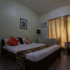 Отель Ponce Suites Gallery Hotel Филиппины, Давао - отзывы, цены и фото номеров - забронировать отель Ponce Suites Gallery Hotel онлайн комната для гостей