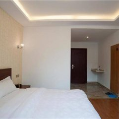 Отель Xiamen Tianhaixuan Holiday Villa Китай, Сямынь - отзывы, цены и фото номеров - забронировать отель Xiamen Tianhaixuan Holiday Villa онлайн комната для гостей фото 4