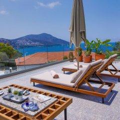 Samira Exclusive Hotel & Apartments Турция, Калкан - отзывы, цены и фото номеров - забронировать отель Samira Exclusive Hotel & Apartments онлайн пляж