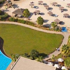 Отель Radisson Blu Resort, Sharjah бассейн фото 3