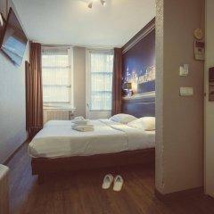 Отель Tourist Inn Budget Hotel - Hostel Нидерланды, Амстердам - 1 отзыв об отеле, цены и фото номеров - забронировать отель Tourist Inn Budget Hotel - Hostel онлайн комната для гостей фото 5