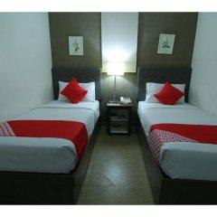 Отель OYO 106 24H City Hotel Филиппины, Макати - отзывы, цены и фото номеров - забронировать отель OYO 106 24H City Hotel онлайн сейф в номере