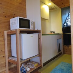 Отель Cottage Orange House Yakushima Якусима удобства в номере