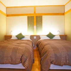 Отель Asagirinomieru Yado Yufuin Hanayoshi Хидзи комната для гостей