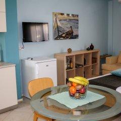 Отель Dynasta Central Suites в номере