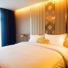 Отель Glow Sukhumvit 5 By Centropolis Бангкок комната для гостей фото 2