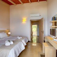 Апартаменты Krouzeri Beach Apartments комната для гостей фото 3