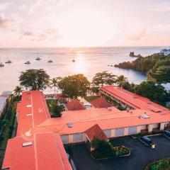 Отель Sunset Shores Beach Hotel Сент-Винсент и Гренадины, Остров Бекия - отзывы, цены и фото номеров - забронировать отель Sunset Shores Beach Hotel онлайн пляж
