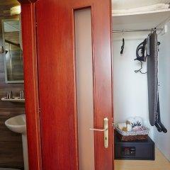 Апартаменты Pettas Apartments сейф в номере