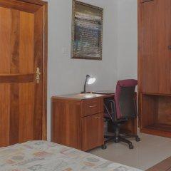 Отель SwissGha Homes Christian Retreat and Hospitality Center удобства в номере