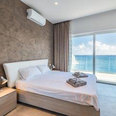 Отель Saint Julian's - Spinola Bay Apartment Мальта, Сан Джулианс - отзывы, цены и фото номеров - забронировать отель Saint Julian's - Spinola Bay Apartment онлайн комната для гостей фото 2