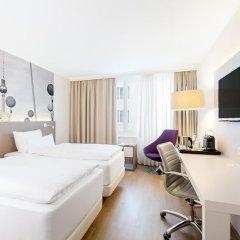 Отель NH Collection Berlin Mitte Am Checkpoint Charlie 4* Стандартный номер с разными типами кроватей фото 42
