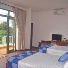 Отель Tra Que Riverside Homestay Вьетнам, Хойан - отзывы, цены и фото номеров - забронировать отель Tra Que Riverside Homestay онлайн комната для гостей фото 5