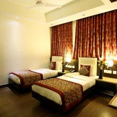 Отель The Prime Balaji Deluxe @ New Delhi Railway Station комната для гостей