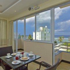Отель Crystal Beach Inn Мале комната для гостей