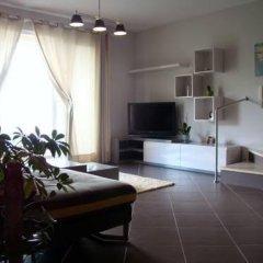 Апартаменты Capo Apartment Тирана комната для гостей