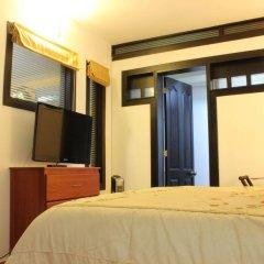 Отель Cali Apartaestudios Колумбия, Кали - отзывы, цены и фото номеров - забронировать отель Cali Apartaestudios онлайн сейф в номере