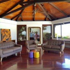 Отель Villa Riviera - Tahiti Французская Полинезия, Пунаауиа - отзывы, цены и фото номеров - забронировать отель Villa Riviera - Tahiti онлайн интерьер отеля
