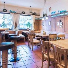 Отель Comfort Hotel Am Medienpark Германия, Унтерфёринг - отзывы, цены и фото номеров - забронировать отель Comfort Hotel Am Medienpark онлайн гостиничный бар
