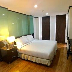 Отель Twin Peaks Sukhumvit Suites Бангкок комната для гостей фото 4