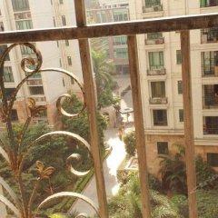 Отель Meiru Rujia Hotel Apartment Китай, Гуанчжоу - отзывы, цены и фото номеров - забронировать отель Meiru Rujia Hotel Apartment онлайн балкон