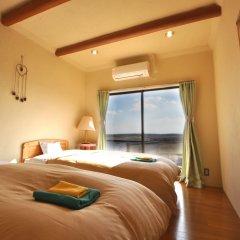 Отель El Patio Ranch Минамиогуни комната для гостей