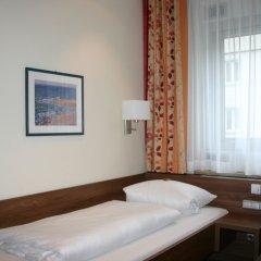 Отель Hauser An Der Universitaet Мюнхен комната для гостей фото 4