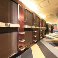 Отель Capsule and Sauna Oriental Япония, Токио - отзывы, цены и фото номеров - забронировать отель Capsule and Sauna Oriental онлайн интерьер отеля фото 3