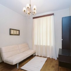 Апартаменты Na Petrogradskoj Apartments Санкт-Петербург комната для гостей