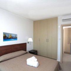 Апартаменты Coralli Spa Протарас сейф в номере