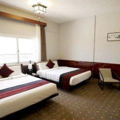 Great Wall Hotel комната для гостей
