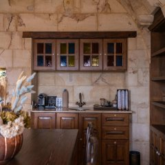 Отель Kayakapi Premium Caves Cappadocia в номере