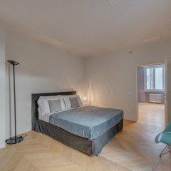 Апартаменты Santa Croce Deluxe 2 Bedroom Apartment Флоренция комната для гостей фото 5