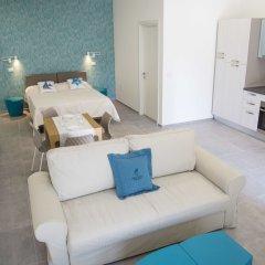 Отель Rivabella Suite Apartments Италия, Римини - отзывы, цены и фото номеров - забронировать отель Rivabella Suite Apartments онлайн комната для гостей фото 2