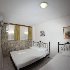 Отель Rüzgargülü Otel Бозджаада комната для гостей
