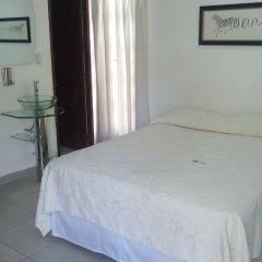 Отель Aparta Hotel Turey Доминикана, Санто Доминго - отзывы, цены и фото номеров - забронировать отель Aparta Hotel Turey онлайн комната для гостей фото 4