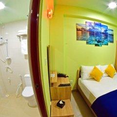 Отель Tourist Inn Мале комната для гостей