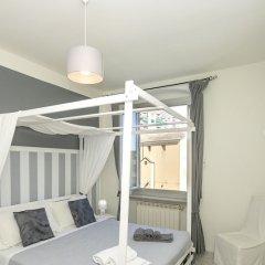 Отель Young Apartment Италия, Генуя - отзывы, цены и фото номеров - забронировать отель Young Apartment онлайн комната для гостей фото 2