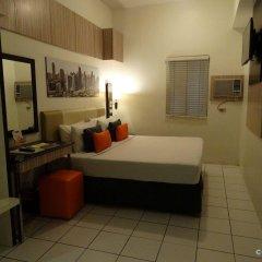 Отель Octagon Mansion Hotel Филиппины, Манила - отзывы, цены и фото номеров - забронировать отель Octagon Mansion Hotel онлайн комната для гостей фото 2