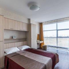 "Апартаменты ""Салют Плюс"" комната для гостей фото 3"