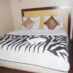 Отель Emglo Suites комната для гостей фото 2