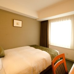 Toshi Center Hotel комната для гостей