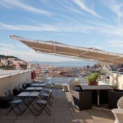 Отель NH Collection Lisboa Liberdade бассейн
