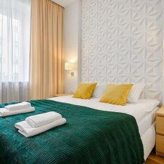 Отель Wspólna Prime Apartment Польша, Варшава - отзывы, цены и фото номеров - забронировать отель Wspólna Prime Apartment онлайн комната для гостей фото 4