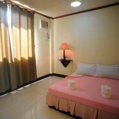 Отель La Chari'ca Inn Филиппины, Пуэрто-Принцеса - отзывы, цены и фото номеров - забронировать отель La Chari'ca Inn онлайн комната для гостей