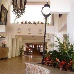 Caleta Hotel интерьер отеля