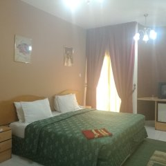 Отель Royal Crown Suites Шарджа комната для гостей фото 6