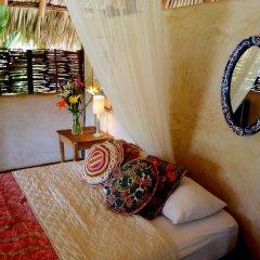 Отель Present Moment Retreat удобства в номере