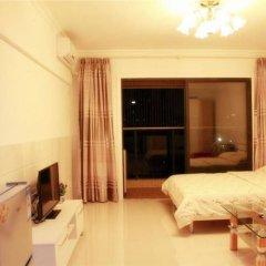 Апартаменты Xingfu Huafu Apartment комната для гостей фото 2